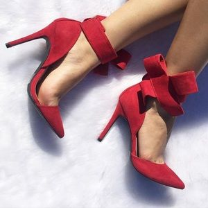 Red pointed toe bow heels